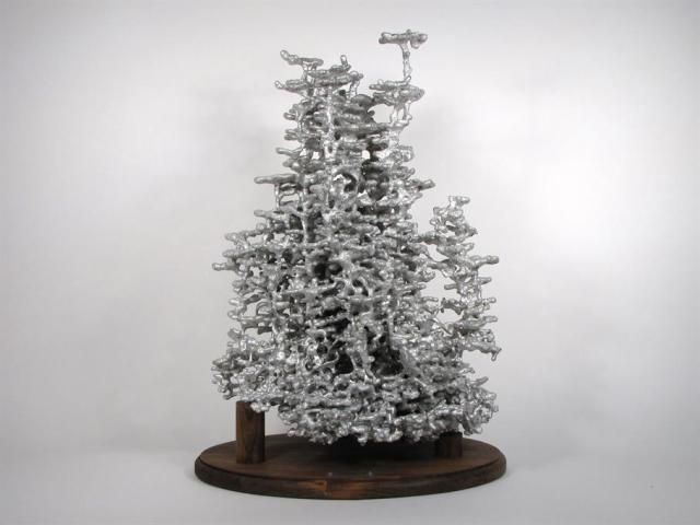 Ant Colony Sculptures Made by Pouring Molten Metal into Ant Nests