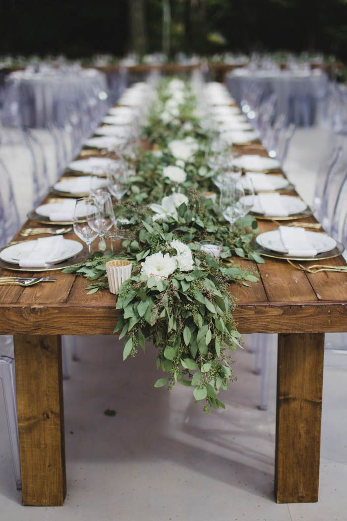 Leafy table runner from this wedding reception in the woods| Image by  Sugar + Soul Photography