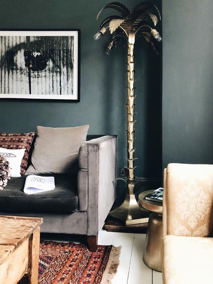 Brass palm tree lamp against emerald green walls. #lamp #palmtree #interiordecor