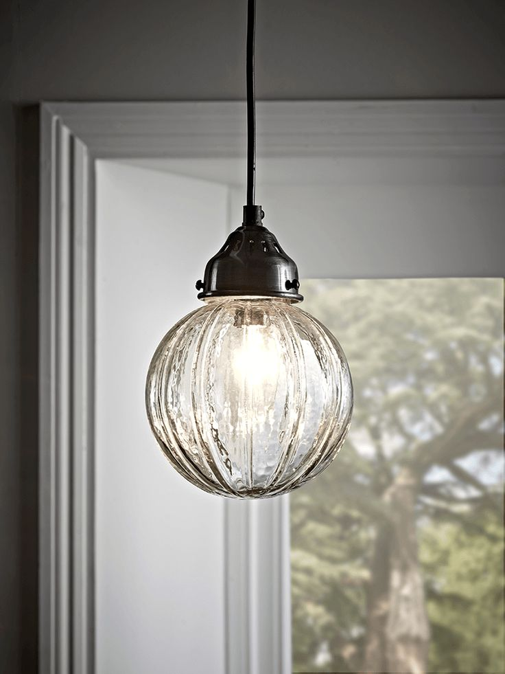 Petite and round in shape with a fluted finish, our stylish glass light has pewter metal fitting details. The delicate fluted design will cast pretty patterns across your living space.