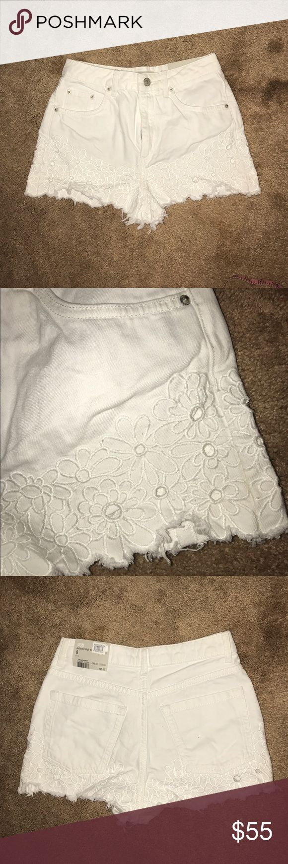 "TOPSHOP DENIM HIGH WAIST SHORTS NWT TOPSHOP NWT HIGH WAIST DENIM SHORTS in a white color with stitched daisy print! These are a ""cut off"" style and are in EXCELLENT CONDITION! NEVER BEEN WORN AT ALL, STILL HAVE TAGS. They said a 4, but they are actually smaller. No rips, tears, or holes located anywhere on the shorts! I included a picture showing that it is actually around a size 25. The inseam is 2 inches and the rise is 11. HAPPY SHOPPING! ***WILL SELL FOR LESS ON Ⓜ️ERCARI*** Topshop…"