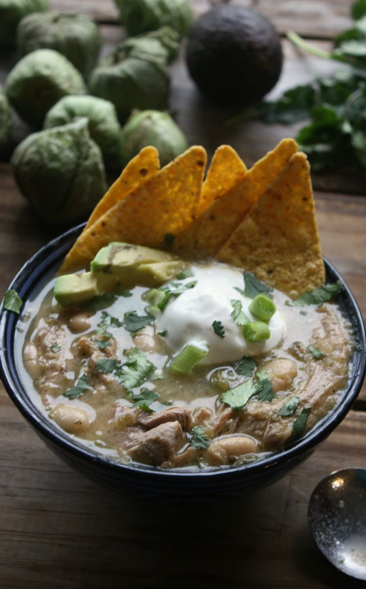 Dive into a delicious bowl of this Slow Cooker Salsa Verde Pork Soup with all the topping that add more flavor and crunch. Recipe