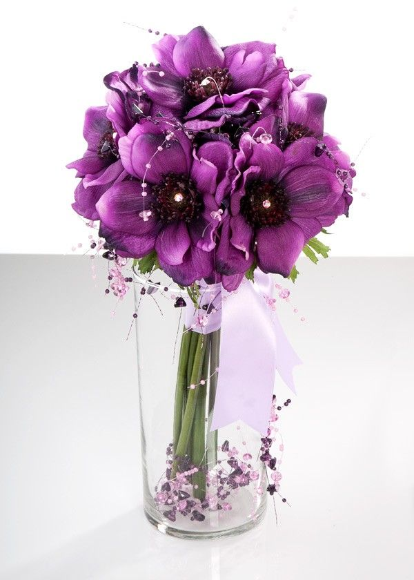 Anemones are available from fall to spring in blue, purple, red, pink and white.Purple Wedding Flower, Spring Flower, Saving Money, Wedding Bouquets, Spring Parties, Wedding Flowers, Purple Bouquets, Center Piece, Purple Flower