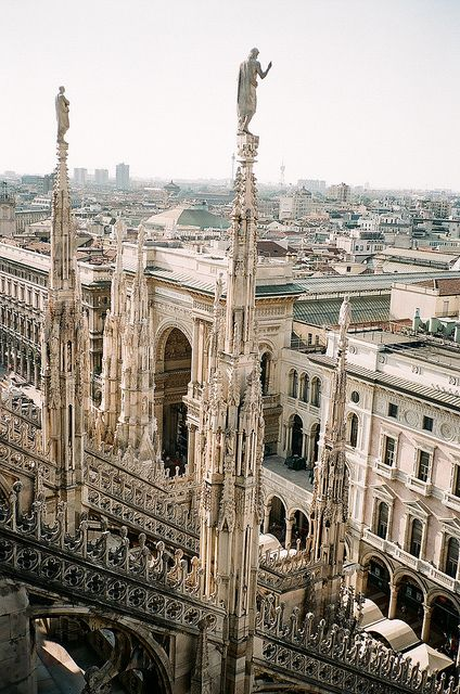Duomo of Milan.  I sat in front of this magnificent structure while drinking hot chocolate (with cream).  While close to it, you could crane your neck heavenward but the building just seemed to go on and on.