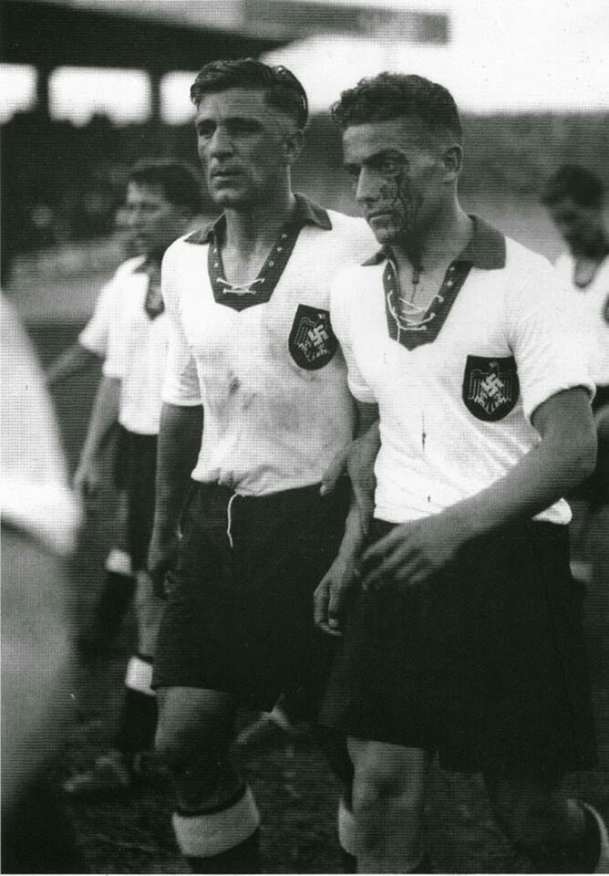 Switzerland 4 W. Germany 2 in 1938 in Paris. The German team leave the pitch looking battered after their World Cup 1st Round Replay.