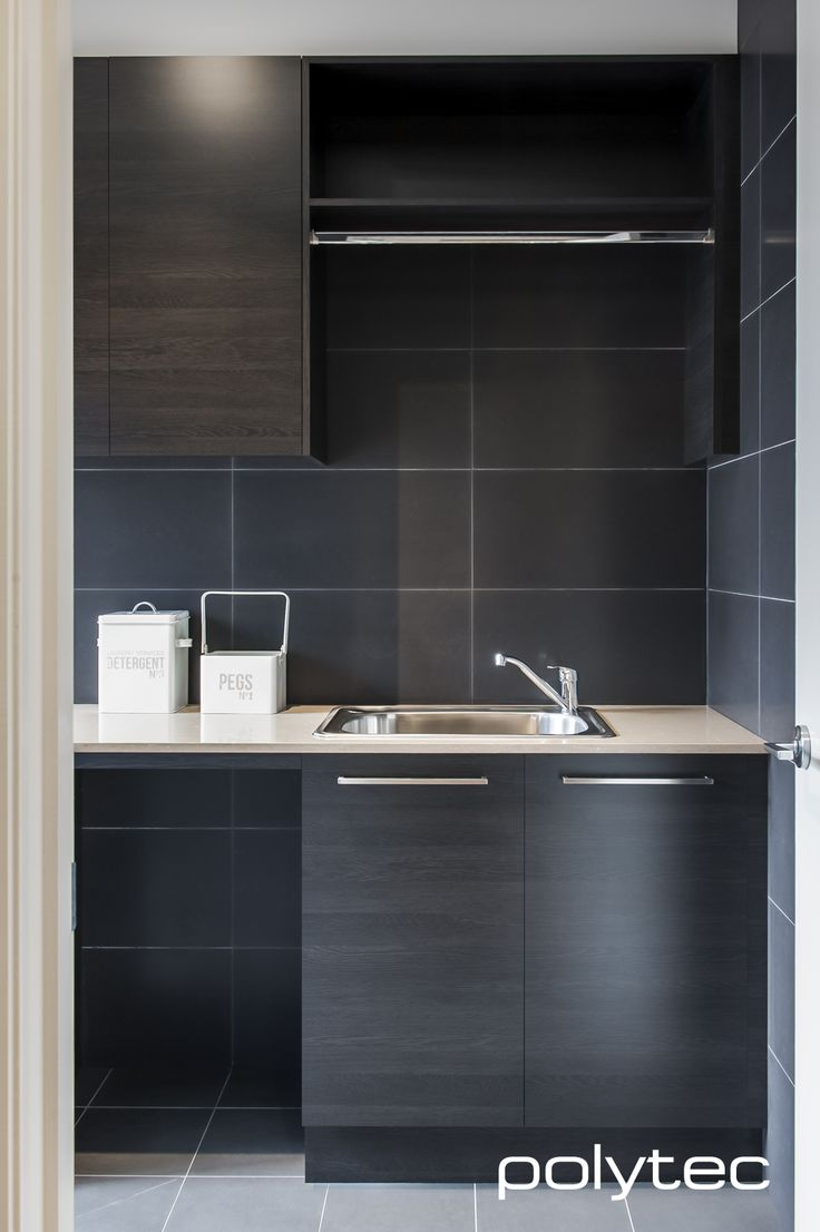 Modern dark timber laundry design in polytec Black Wenge RAVINE.https://www.polytec.com.au/colour/black-wenge/