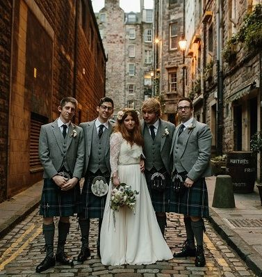 Kate and Steve with the groomsmen in our Blue Ramsay tartan #kilts and our #exclusive Lomond Mist jackets and waistcoats, in the old streets of #Edinburgh on their #wedding day. #macgregorandmacduff #kingsofkilts #scottish #highlandwear #wedding