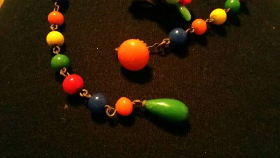 I have for sale a vintage art glass wired necklace and clip on earrings. They are signed Japan. Very fun....Hope you enjoy