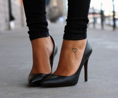 cute little heart tattoo. I would love to get a small one like this on my finger
