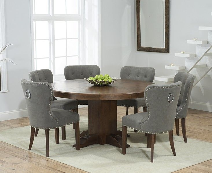 Buy the Torino 150cm Dark Solid Oak Round Pedestal Dining Table with Knightsbridge Fabric Dark Oak Leg Chairs at Oak Furniture Superstore