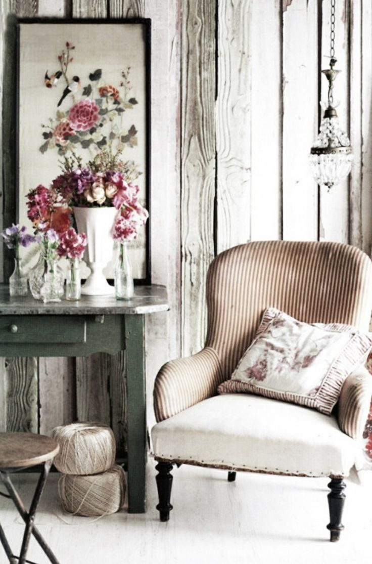 Rustic plank, wall, lovely vignette, and deconstructed chair.