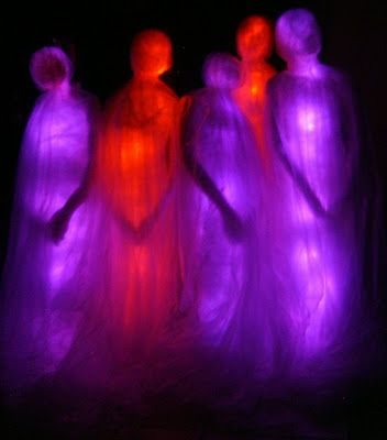 Their bodies are made with bubble wrap, packing tape, and clear plastic drop clothes. Inside is a line of LED lights that when turned on makes the form glow. In daylight they look far less impressive than at night when they are lit.