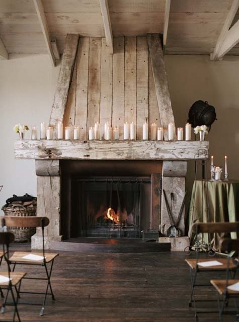What we like - example of large beam holding mantel, a lighter version of reclaimed wood as potential for sides, wrap around mantel with the top getting more narrow on top of the mantel. We want more stone surrounding the fireplace, etc than this picture shows.