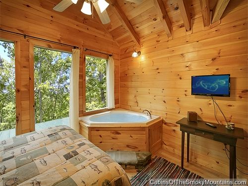 """Bedroom in Gatlinburg luxury cabin """"Mountain Blessing"""" with TV, jacuzzi, deck and Smoky Mountains!"""