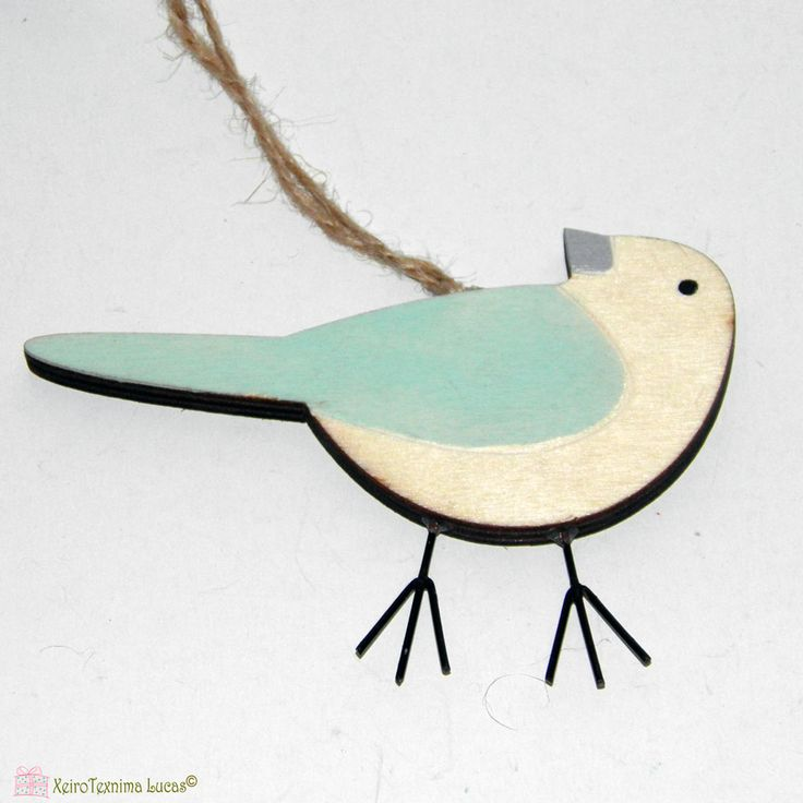 Ξύλινο, διακοσμητικό πουλάκι. Wooden bird ornament.