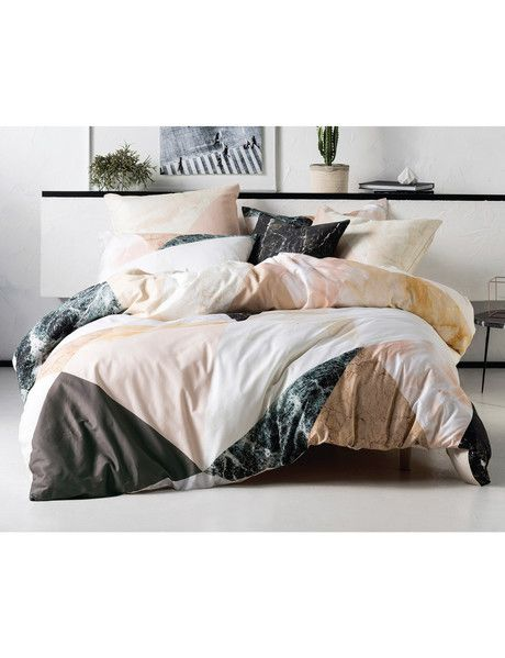 Earthy and elemental, this modern geometric duvet cover set features an on-trend colour palette of soft pink, apricot, grey and white.