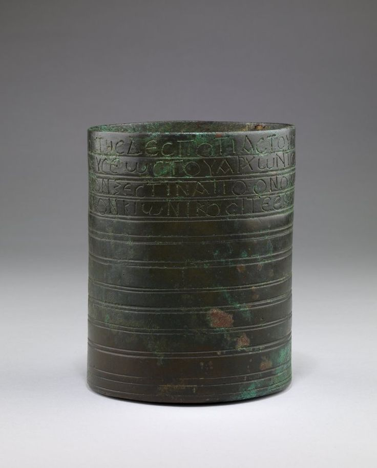 Measuring cup; cast bronze; cylindrical form with vestiges of a handle; decorated with incised transverse grooves; around the rim a Greek inscription. Culture/periodEarly Byzantine term details Date6thC FindspotFound/Acquired: Antioch, First seen by René Mouterde (1880-1961), in 1913 in Beirut. (?) term details(Asia,Turkey,Mediterranean Region (Turkey),Hatay (province),Antioch)