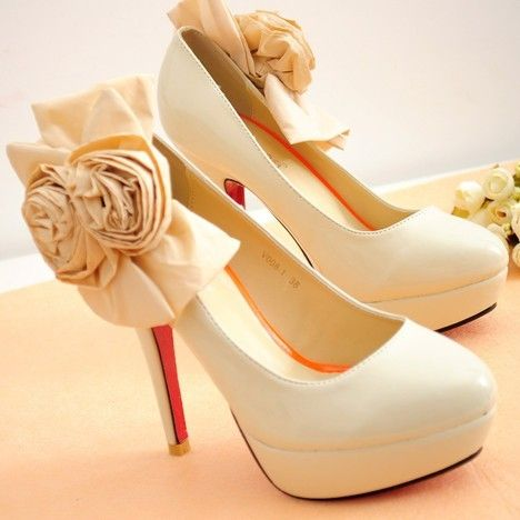 Yes, these are ridiculously high heels, and yes, I do love them. Ivory heels with with rosette and bow embellishment.