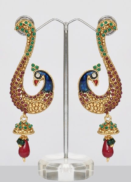 Golden finish peacock earrings studded with shining and sparkling white, red and green color stones and meenakari art.