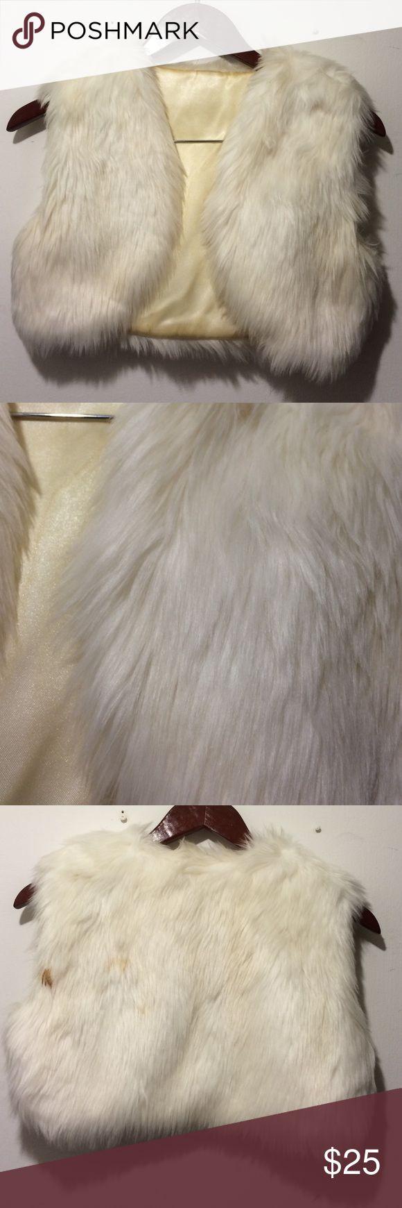 Faux fur bolero Faux fur cropped bolero in white. Fully lined, sleeveless. Stain at back left Jackets & Coats
