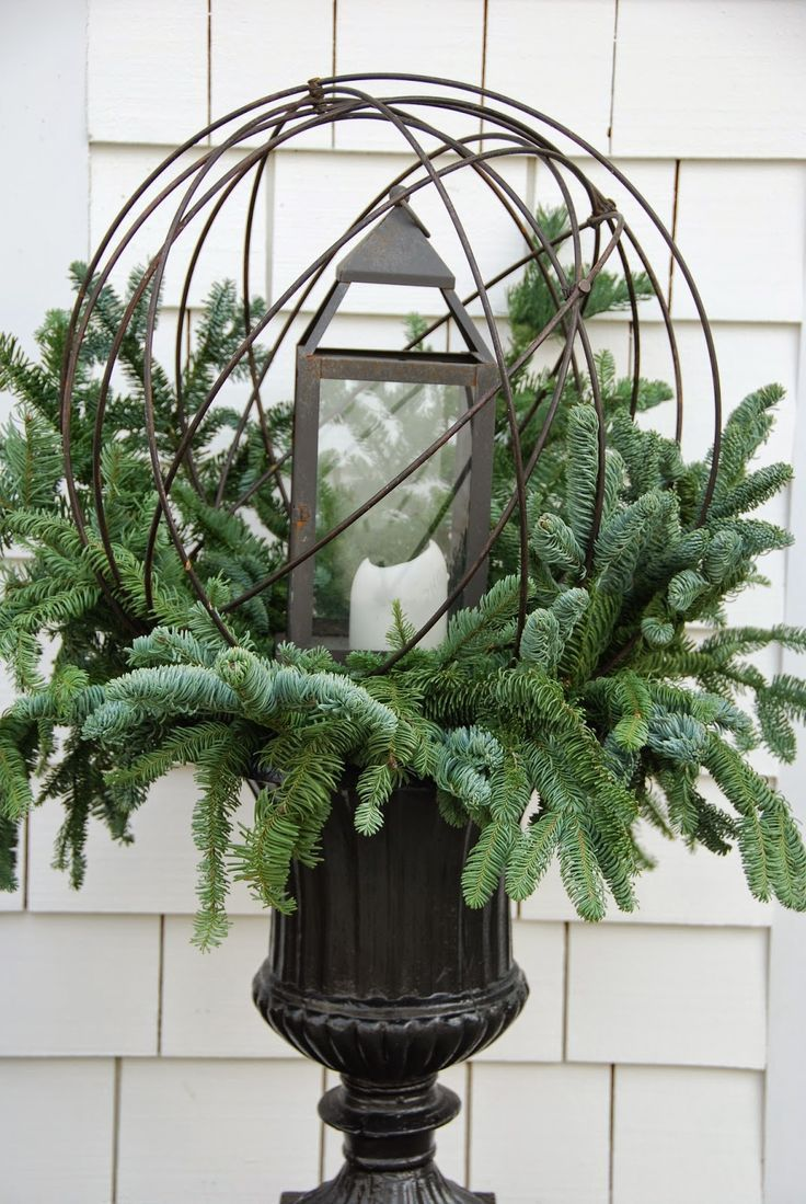 grapevine balls in urns - use holly, boxwood,…