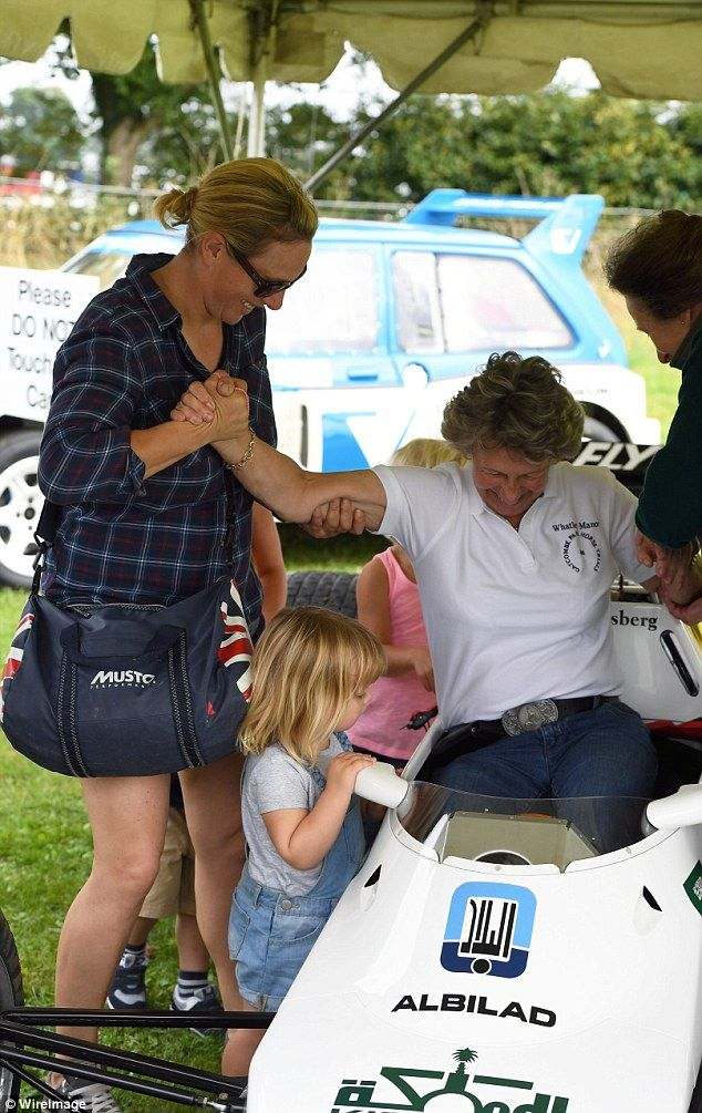 Mia Tindall kept a close eye as Princess Anne and Zara Phillips helped a woman get out of a car