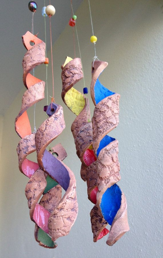 Wind chimes are natures music. We are happy to offer autumn leaves, seashells, brown clay coils and fish chimes. The ceramic pieces are