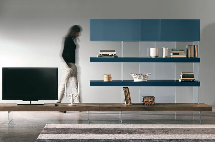 Air by Lago @ GLOTTMAN: Air is a system of tops and shelves that create tables and bookcases. The substantial thickness of the shelves contrasts with the buoyancy of the Starphire® glass interlocking supporting structure, giving each composition a floating appearance.