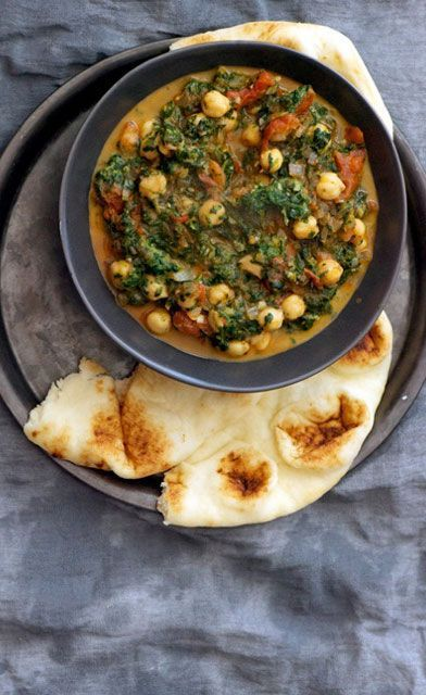 This Curried Chickpeas With Spinach And Tomatoes recipe is easy enough to throw together for a weeknight dinner.
