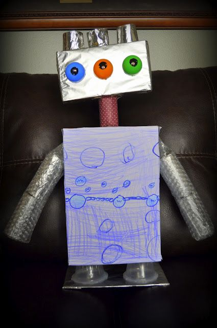 I remember having to make a robot as a homework project in Kindergarten and when everyone brought them to school, they were all so neat and different.  Maybe one day I'll have all my fellow mom friends over and tell them to bring random trash and materials and we'll make robots!