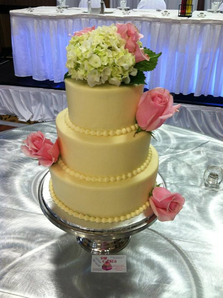 3 tier round wedding cake, smooth sides, bead border, real flowers ...