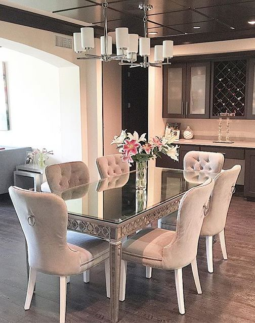 Our Sophie Mirrored Dining Table elegantly reflects its surroundings to merge glamour with modernism. Our Charlotte Dining Chairs are a textured touch. Photo via @tanyafarahinteriordesign.