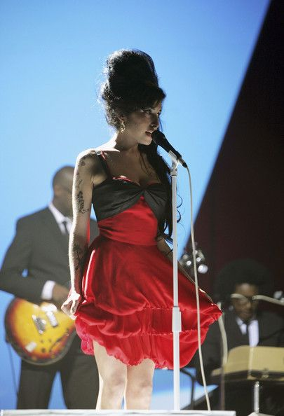Amy Winehouse Photos Photos - (UK TABLOID NEWSPAPERS OUT) Amy Winehouse rehearses on stage prior to the BRIT Awards 2007 at Earls Court 1 on February 14, 2007 in London, England. - Rehearsals At The Brit Awards 2007