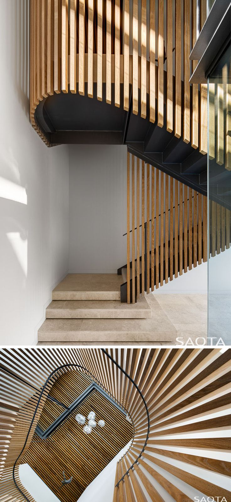 This modern house has a black staircase is wrapped in a cloak of timber louvres.#Stairs #BlackStairs #WoodStairs