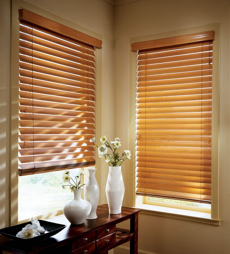 Honey coloured wooden blinds, cast beautiful light effects in a room.