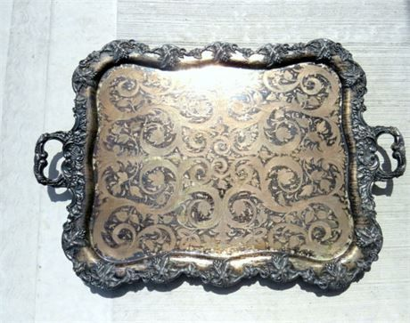 Huge vintage very heavy, ornate detailing with leaves tray. This very large butler serving tea tray is stunning. The metal looks as if its silver plated over copper (although no marking can be found) The copper section of the tray looks as if its an inlay pressed in due to the detailing. You can also see faint details of the pattern on the back of the tray, indicating it was put there with pressure. The tray weighs app 9 pounds maybe a little more. It measures app 24 wide not including the…