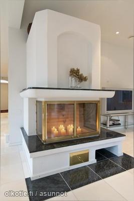 Fireplace with candels in it / Kynttilöillä koristeltu takka