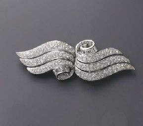AN ART DECO DIAMOND DOUBLE-CLIP BROOCH Each clip designed as a pavé-set diamond scroll, enhanced by baguette-cut diamond trim, mounted in platinum and 18k white gold, circa 1930, with French assay marks and maker's marks
