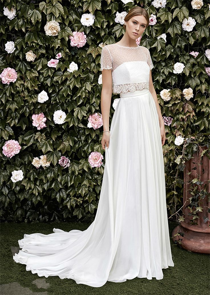 Fresh florals and a wall of greenery star as the landscape for Cristina Tamborero's 2016 bridal collection inspired by the Garden of Eden. Noble fabrics...