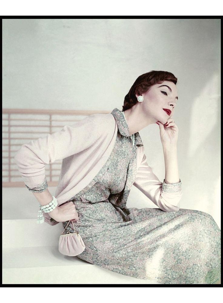 Model wearing Liberty silk dress under a cashmere cardigan Vogue Jan 1954