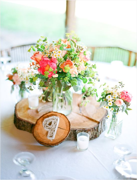 Ali and Mike get some wood centerpieces cut for flower vases. Rustic wedding centerpiece by Holly Chapple Flowers