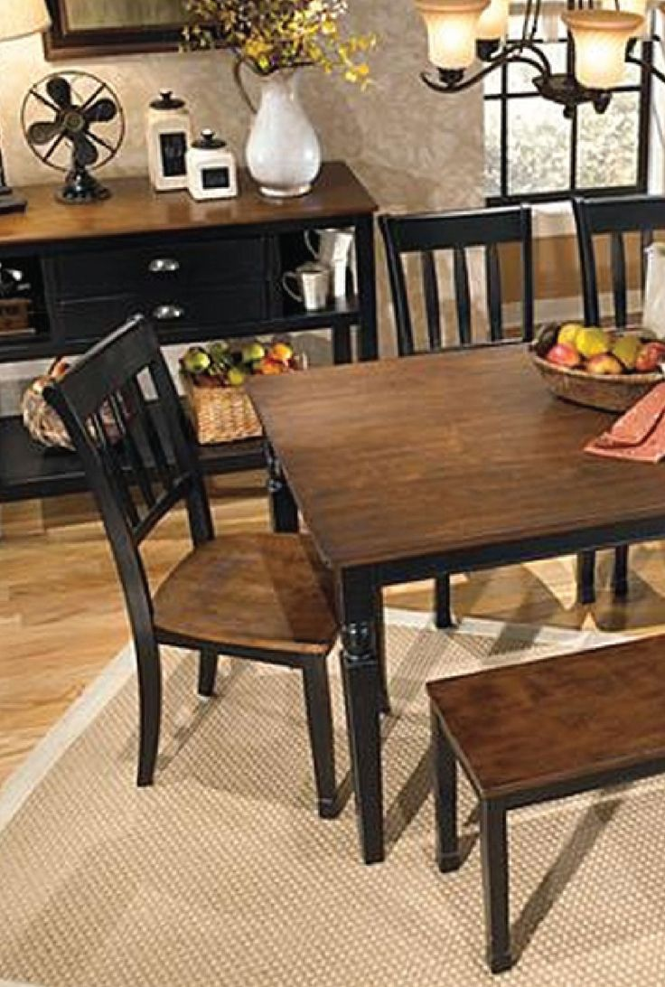 This farmhouse-style table is an elegant and beautiful addition to your dining room décor. Sleek wood is placed against a black finish to create a homey two-tone table that is welcoming and sophisticated.
