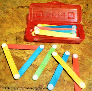 "DIY Toddler Activities - craft sticks and Velcro dots... ""Busy bag"" okay weird. i'm only pinning this because when i first saw it, i thought those were RPE keys hahaha wut"