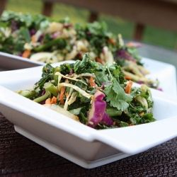 colorful raw kale salad paired with an Asian inspired dressing.