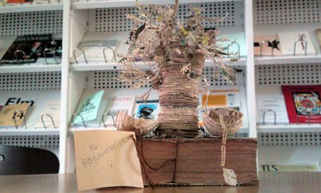 So far none of the Scottish Poetry Library staff know who left them this tree made from books...