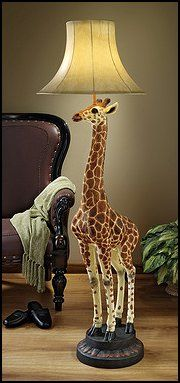 At over five feet tall, our statuesque giraffe stretches to create a sculptural floor lamp seemingly fresh from an African safari! Replete with lifelike detail from gentle eyes to pert ears, our Basil Street exclusive quality designer resin animal statue is a scaled, 360-degree sculpt hand-painted in natural tones and crowned with a faux leather shade to cast the warm glow of Africa throughout your exotic decor.