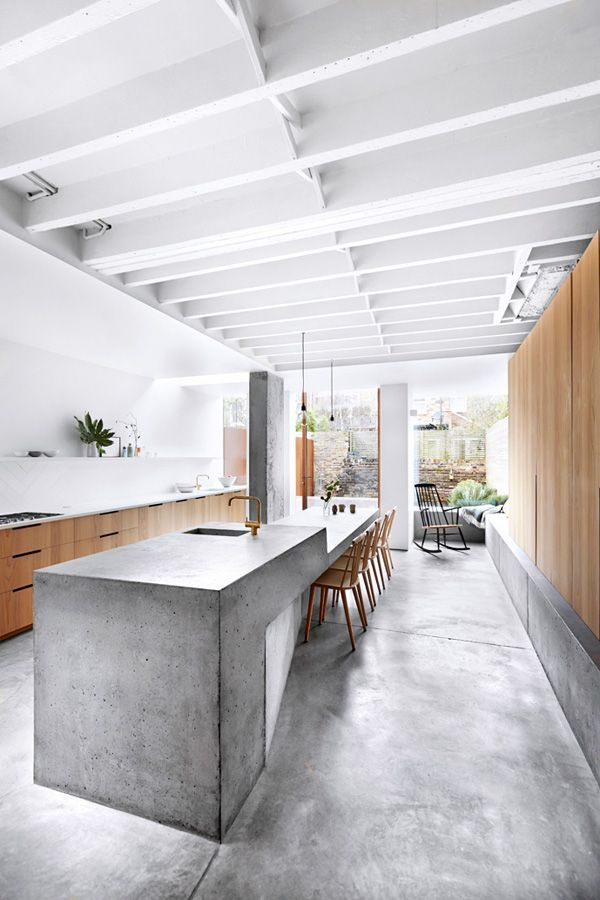 We're absolutely loving the two-toned nature of this sprawling kitchen, which is perfectly balancing concrete and wood together for a multi-faceted look without the clutter. As it turns out, if you choose the right materials, a healthy wash of natural light is all the decor you need. Read more at: https://nyde.co.uk/blog/springs-concrete-trend/