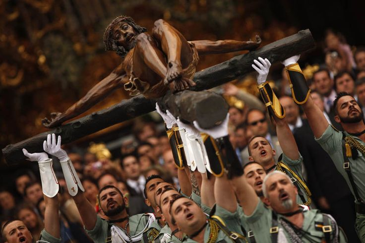 Spanish legionnaires (members of Spanish Foreign Legion, an elite unit of the Spanish Army and Spain's Rapid Reaction Force) sing an anthem as they carry a statue of the Cristo de la Buena Muerte or Cristo de Mena (Christ of the Good Death or Christ of Mena, sculpted by Pedro de Mena) during the Semana Santa (Holy Week) in Málaga, Spain, April 21, 2011. (Reuters/Jon Nazca)