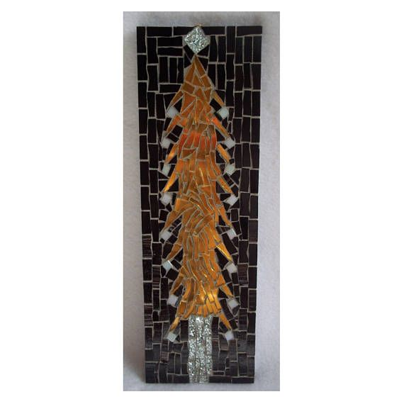 Light gold Christmas tree with black background and gray grout. The wood was painted with a protective finish before tiling and grouting. The back is spray painted black. The mosaic weighs less than a pound and is easy for wall hanging. A small triangle D-ring picture frame hanger