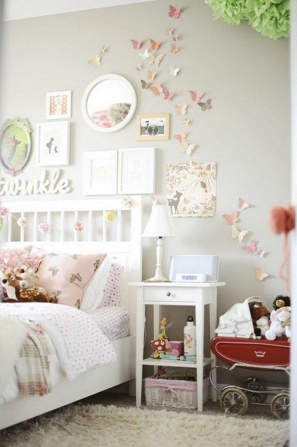 Light pink and grey bedroom for teenage girls. Decorate the wall with paper butterflies in pastel colors, the framed wall art, a white round decorative mirror in right size.